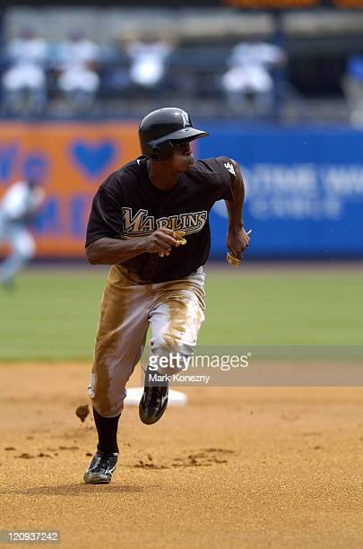Florida Marlins outfielder Juan Pierre runs for third base during a game against the New York Mets at Shea Stadium New York NY on July 2 2005 Florida...