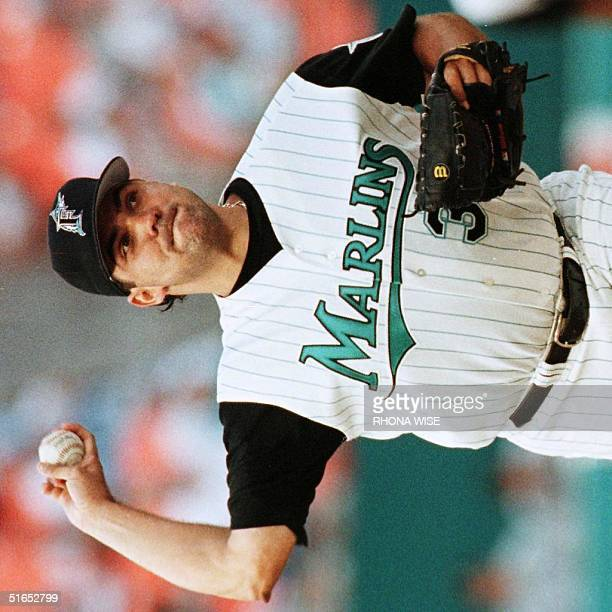 Florida Marlins pitcher Alex Fernandez gets ready to throw to first base on a pickoff attempt in the third inning of their game 29 May against the...