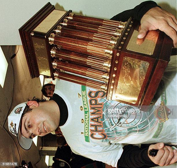 Florida Marlins pitcher Alex Fernandez holds the National League Championship Series trophy after his team's 74 victory over the Atlanta Braves 14...
