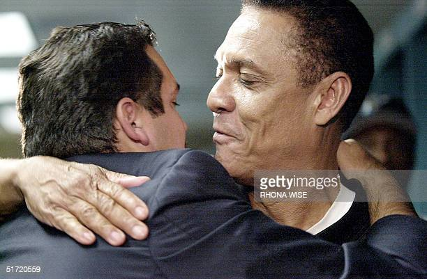 Florida Marlins' pitcher Alex Fernandez hugs Marlins' manager Tony Perez after Fernandez announces his retirement to the media 26 September 2001 at...