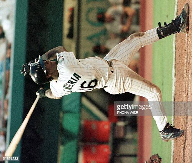 Florida Marlins player Edgar Renteria connects on the gamewinning base hit in the bottom of the ninth inning against the San Francisco Giants 30...