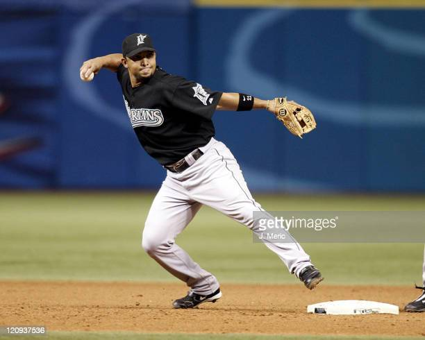 Florida Marlins shortstop Alex Gonzalez prepares to step on second base to begin a late inning double play in Saturday night's game against the Tampa...