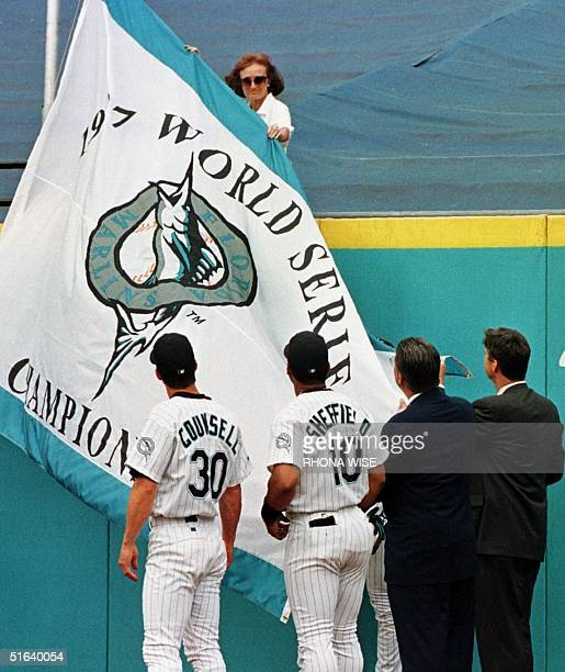 Florida Marlins team members Craig Counsell and Gary Sheffield along with Marlins President Don Smiley and General Manager Dave Dombrowski help raise...