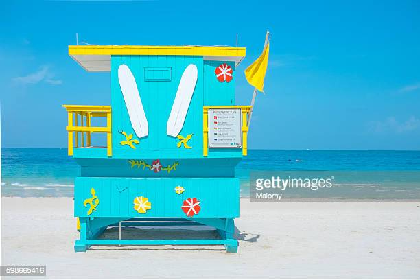 usa, florida, miami beach. lifeguard tower on beach with yellow flag - shack stock pictures, royalty-free photos & images