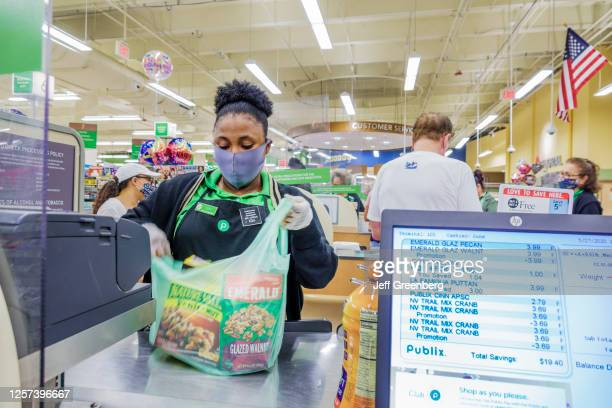 Florida, Miami Beach, Publix, supermarket check out cashier during Coronavirus Pandemic. On May 27, 2020.