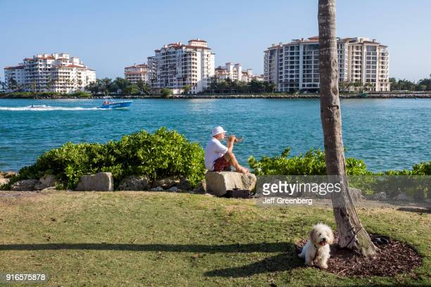 Florida Miami Beach South Pointe Park Trumpet Player with Dog