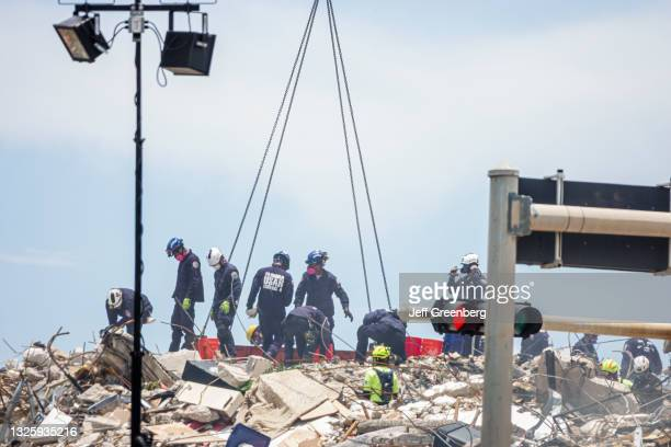 Florida, Miami Beach, Surfside, Champlain Towers South Condominium Building Collapse, Urban Search & Rescue team searching debris for signs of life,...