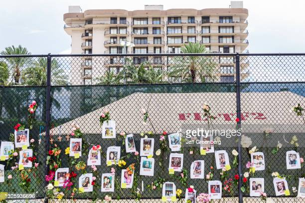 Florida, Miami Beach, Surfside, Champlain Towers South Condominium Building Collapse, remaining standing structure, memorial fence wall with photos...