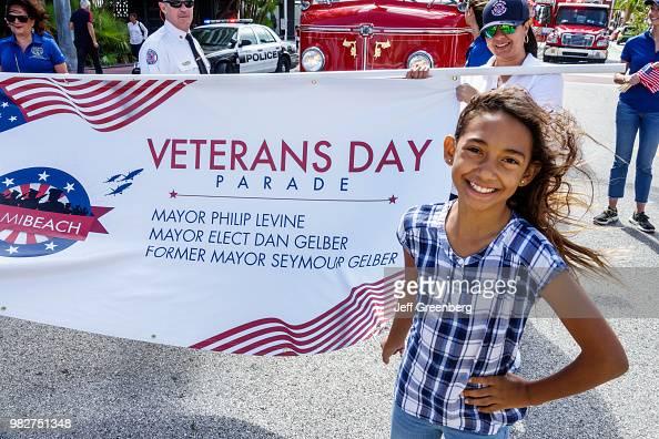 Florida, Miami Beach, Veterans Day parade, teen with banner