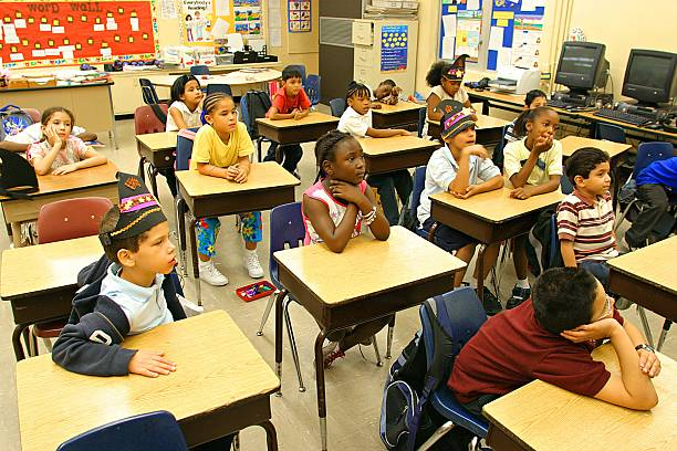 elementary school students in classroom pictures getty images