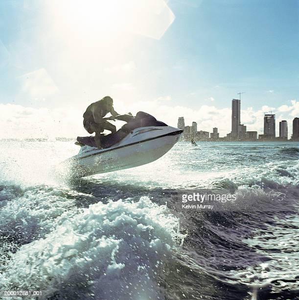 USA, Florida, Miami, man riding jet boat