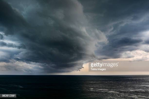 usa, florida, miami, storm clouds over sea - nube temporalesca foto e immagini stock