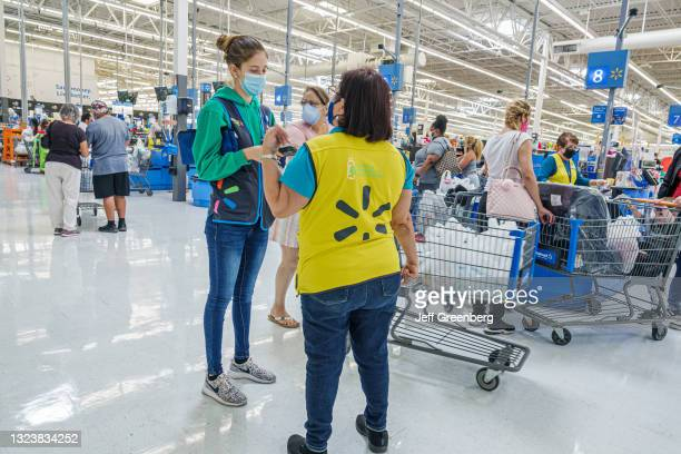 Florida, Miami, Walmart discount department store, check out lines.