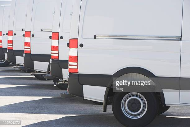 usa, florida, miami, white trucks parked side by side - van stock pictures, royalty-free photos & images
