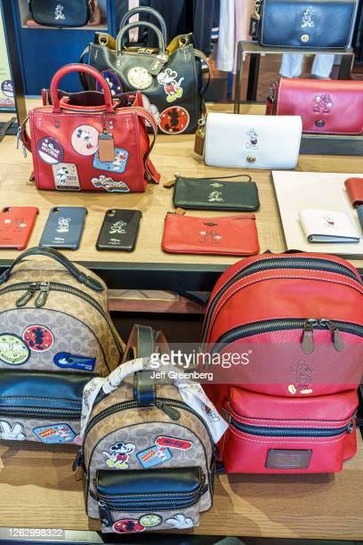 Florida, Orlando, Coach, luxury handbags and Disney Collection, backpacks display.