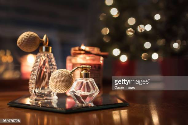 close-up of perfume sprayers on wooden table - perfume stock pictures, royalty-free photos & images