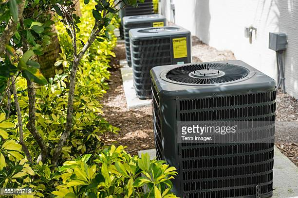 USA, Florida, Palm Beach, Air conditioning unit in garden