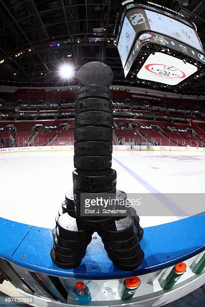 Florida Panther practice pucks stacked in the shape of the Eiffel Tower before the game between the Florida Panthers and the Tampa Bay Lightning at...