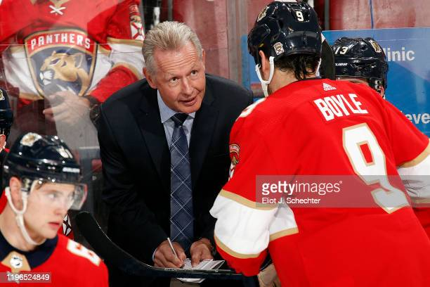 Florida Panthers Assistant Coach Mike Kitchen directs Brian Boyle during a break in the action against the Detroit Red Wings at the BB&T Center on...