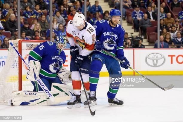 Florida Panthers Center Aleksander Barkov gets hit with the puck in front of Vancouver Canucks Goaltender Jacob Markstrom as Defenseman Alexander...