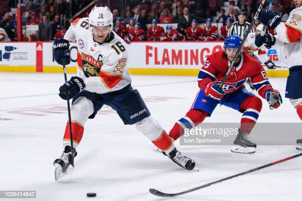 Florida Panthers center Aleksander Barkov moves the puck forward during the first period of the NHL preseason game between the New Florida Panthers...