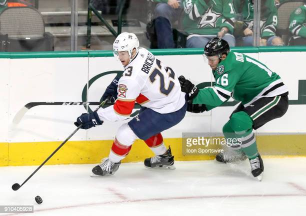 Florida Panthers center Connor Brickley tries to skate past Dallas Stars center Jason Dickinson during the game between the Dallas Stars and the...