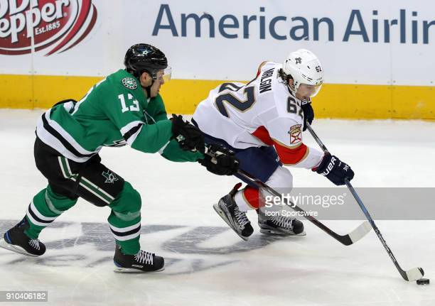 Florida Panthers center Denis Malgin tries to skate past Dallas Stars center Mattias Janmark during the game between the Dallas Stars and the Florida...