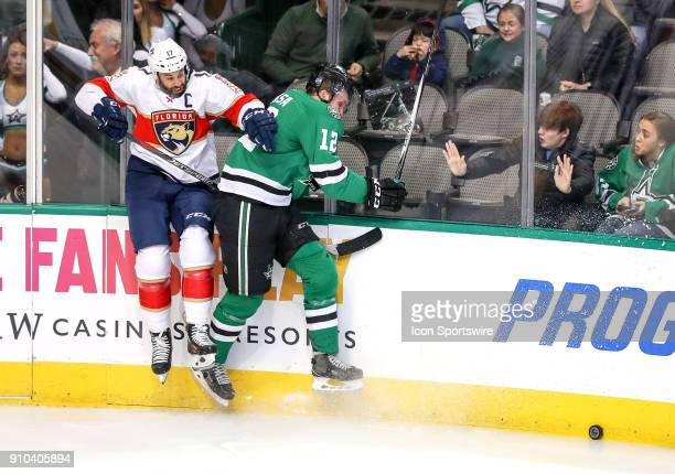 Florida Panthers center Derek MacKenzie gets hit to the boards by Dallas Stars center Radek Faksa during the game between the Dallas Stars and the...