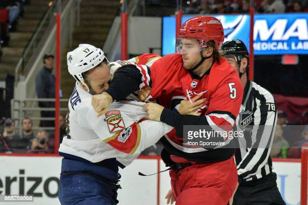 Florida Panthers Center Derek MacKenzie gets punched in the face by Carolina Hurricanes Defenceman Noah Hanifin during a game between the Florida...