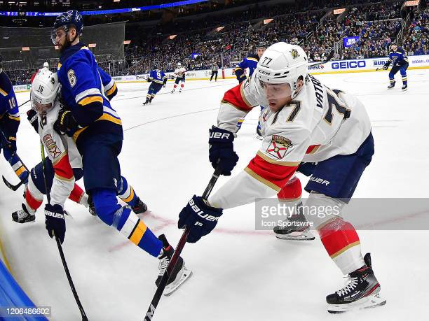 Florida Panthers center Frank Vatrano competes for the puck on the boards during an NHL game between the Florida Panthers and the St. Louis Blues, on...