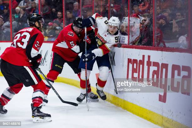 Florida Panthers Center Henrik Borgstrom is pinned to the boards by Ottawa Senators Defenceman Cody Ceci during third period National Hockey League...