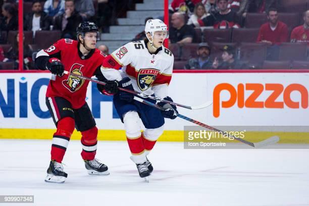 Florida Panthers Center Henrik Borgstrom jockeys with Ottawa Senators Left Wing Ryan Dzingel during third period National Hockey League action...