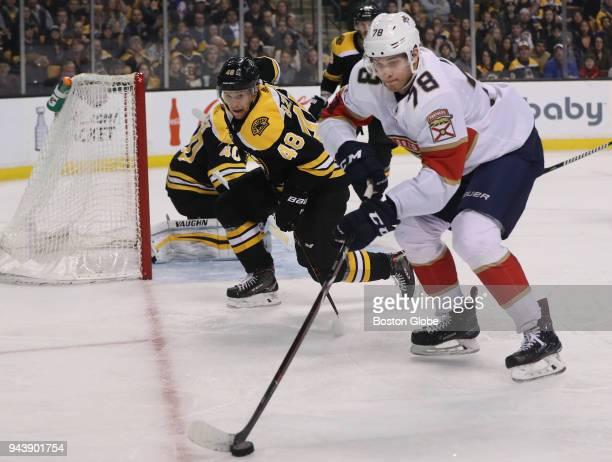Florida Panthers center Maxim Mamin controls the puck with pressure from Boston Bruins defenseman Matt Grzelcyk during the third period The Boston...