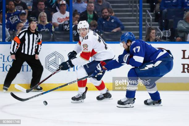 Florida Panthers center Maxim Mamin is defended by Tampa Bay Lightning defenseman Victor Hedman in the 1st period of the NHL game between the Florida...