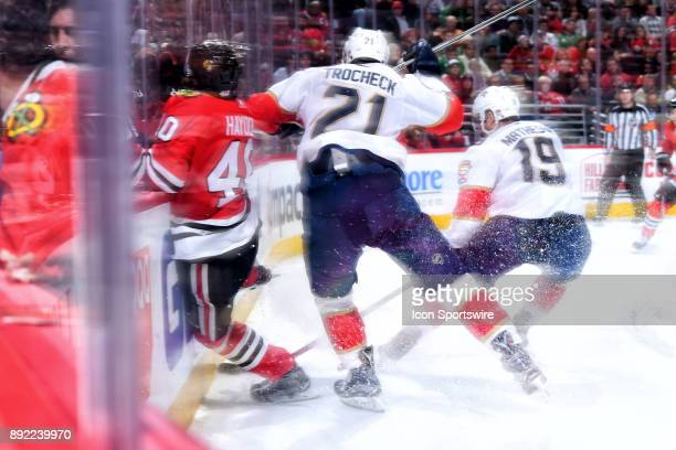 Florida Panthers center Vincent Trocheck checks Chicago Blackhawks right wing John Hayden into the boards in action during the second period of a...