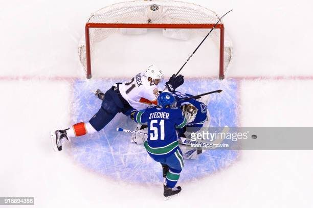 Florida Panthers Center Vincent Trocheck crashes into Goalie Jacob Markstrom as Vancouver Canucks Defenceman Troy Stecher defends during their NHL...