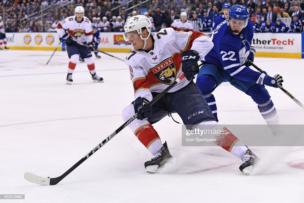 Florida Panthers Center Vincent Trocheck (21) is chased by Toronto Maple Leafs Defenceman Nikita Zaitsev (22) during the regular season NHL game between The Florida Panthers and Toronto Maple Leafs on February 20, 2018 at Air Canada Centre in Toronto, ON.