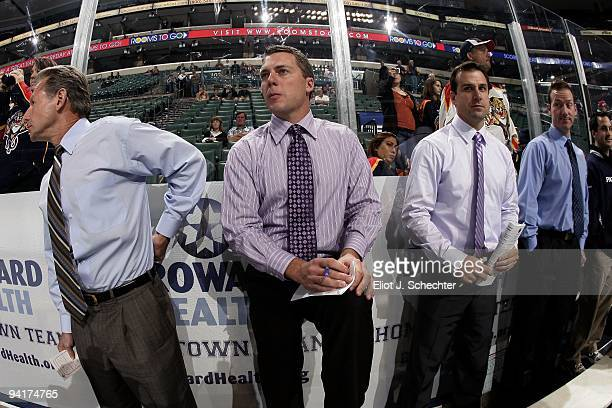 Florida Panthers coaching staff Mike Kitchen, Jim Hulton, Rob Tallas and Jamie Pringle takes notes during pre-game warm ups against the Edmonton...
