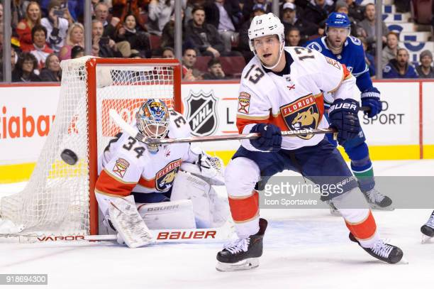 Florida Panthers Defenceman Mark Pysyk clears the puck during their NHL game against the Vancouver Canucks at Rogers Arena on February 14 2018 in...