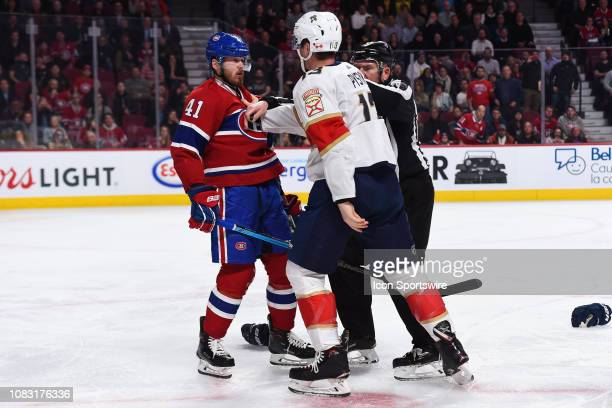 Florida Panthers defenceman Mark Pysyk pushes Montreal Canadiens left wing Paul Byron for a fight after a bad hit during the Florida Panthers versus...