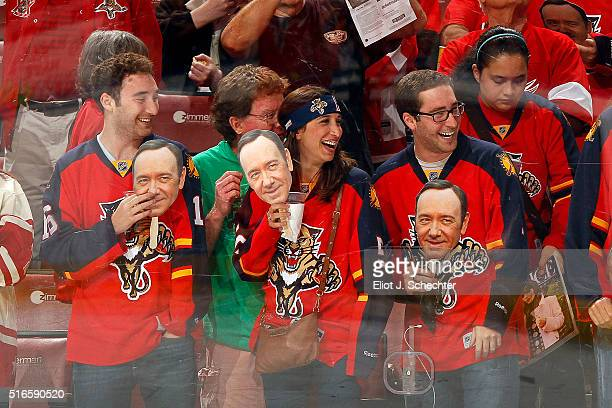 Florida Panthers fans watch warmups holding Kevin Spacey masks prior to the start of the game against the Detroit Red Wings at the BBT Center on...