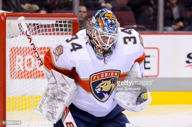 Florida Panthers Goalie James Reimer stops the puck with his mask during their NHL game against the Vancouver Canucks at Rogers Arena on February 14...
