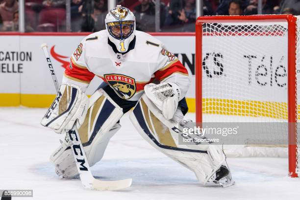 Florida Panthers goalie Roberto Luongo follows the puck carrier during the first period of the NHL preseason game between the Florida Panthers and...