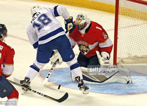 Florida Panthers goalie Roberto Luongo turns away the Tampa Bay Lightning's Ondrej Palat in the first period during a preseason game at the BBT...