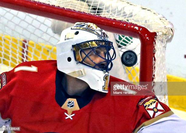 Florida Panthers goalie Roberto Luongo watches a puck gets stuck in the net for a score in the first period as they play Ottawa Senators at the BBT...