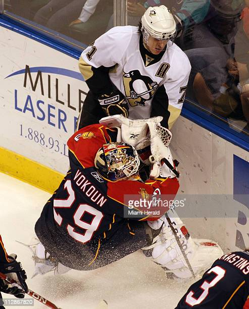 Florida Panthers goalie Tomas Vokoun is knocked down behind the net by Pittsburgh Penguins' Evgeni Malkin during first period action at the Bank...