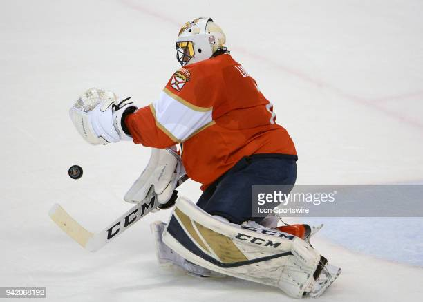 Florida Panthers goaltender Roberto Luongo traying to block the puck during the first period in a game between the Florida Panthers and the Nashville...