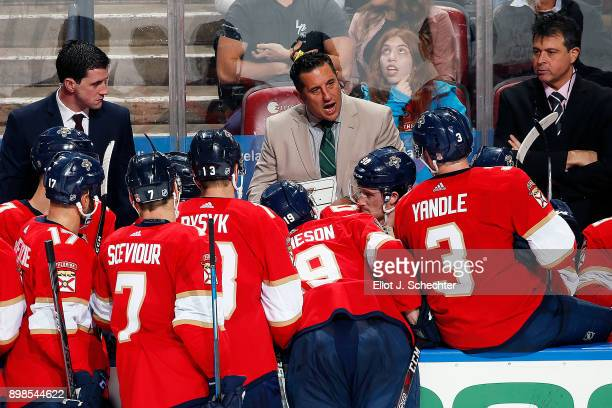 Florida Panthers Head Coach Bob Boughner along with Assistant Coach Paul McFarland and Associate Coach Jack Capuano directs their team from the bench...