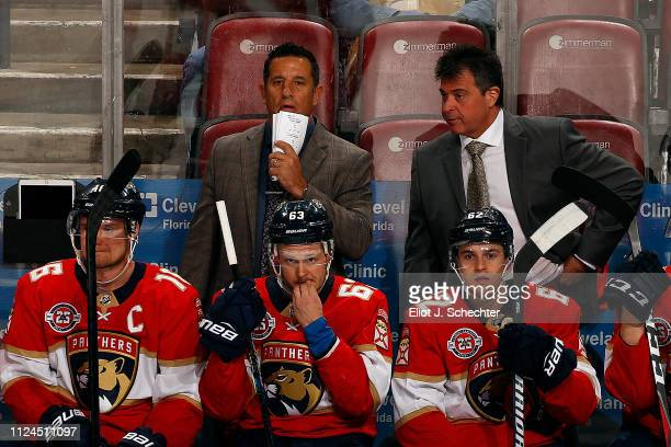 Florida Panthers Head Coach Bob Boughner and Associate Coach Jack Capuano direct their team from the bench against the Dallas Stars at the BBT Center...