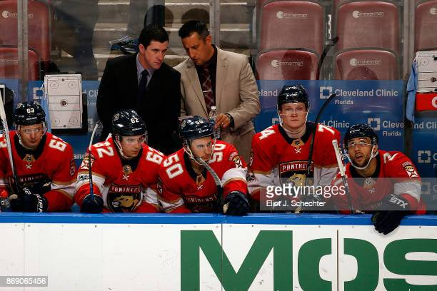 Florida Panthers Head Coach Bob Boughner chats with Assistant Coach Paul McFarland during a break in the action against the Tampa Bay Lightning at...